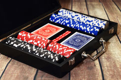 Poker set in suitcase on wooden table Royalty Free Stock Photo