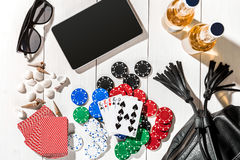 Poker. Set to playing poker with cards and chips on white wooden table, top view Stock Images