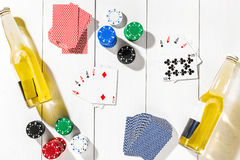 Poker. Set to playing poker with cards and chips on white wooden table, top view Royalty Free Stock Photos