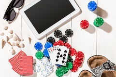 Poker. Set to playing poker with cards and chips on white wooden table, top view Stock Photos