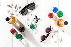 Poker. Set to playing poker with cards and chips on white wooden table, top view Royalty Free Stock Photo