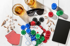 Poker. Set to playing poker with cards and chips on white wooden table, top view Stock Photo