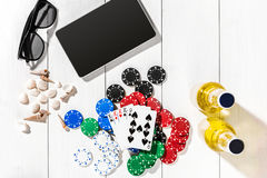 Poker. Set to playing poker with cards and chips on white wooden table, top view Royalty Free Stock Image