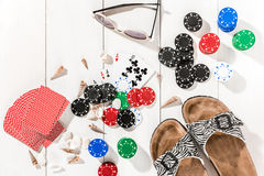 Poker. Set to playing poker with cards and chips on white wooden table, top view Stock Image