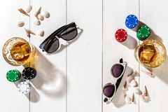 Poker. Set to playing poker with cards and chips on white wooden table, top view Royalty Free Stock Photography