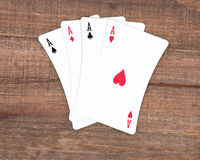 Poker som fyra spelar kort Arkivbild