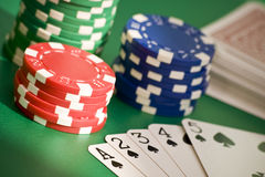 Poker straight flush. Poker game straight flush, chips and deck of cards royalty free stock image