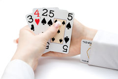 Poker straight with jocker in the sleeve Royalty Free Stock Photo