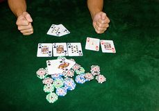Poker table. With chips and cards on it Royalty Free Stock Images