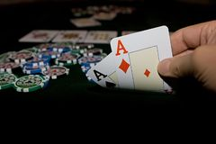 Poker table. With chips and cards on it Stock Photo