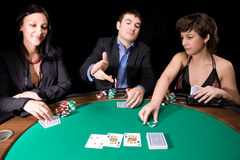 Poker table. Company of friends having fun with the casino poker table Royalty Free Stock Photos