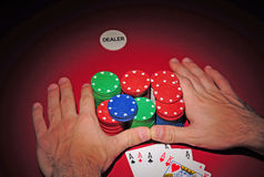 Poker table. All in with four of a kind. Poker player going all in pushing his chips on a red poker table having in his hand four of a kind Royalty Free Stock Photos