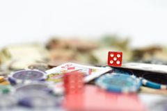 Poker table with cards, dice, poker chips and money in background royalty free stock images