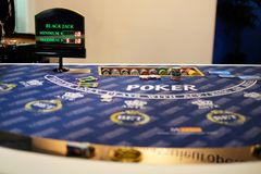 Poker table in a casino. Blackjack and poker table in a casino with some chips placed on it Stock Photos