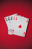 Poker table with full house. A red poker table with full house. The light in the scene is spot like Royalty Free Stock Image
