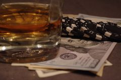 Poker table with money and whiskey. royalty free stock photography