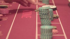 Poker table. The return of the chips won. Casino. Poker chips on the table close up stock video