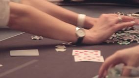 Poker table. The return of the chips won. Casino. Poker players at the table make bets. In the frame only the table and hands stock footage