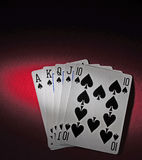 Poker table with royal flush. A red poker table with royal flush. The light in the scene is spot like Stock Images