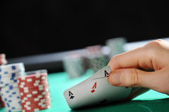 Poker texas holdem: Two Aces. Player looking down at a pocket pair of aces in Texas Hold'em poker game Royalty Free Stock Images