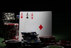 Poker theme. Poker table with cards and counters Royalty Free Stock Image