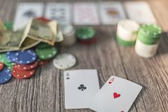 Poker theme with money. chips and cards stock photo