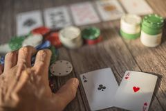 Poker theme scene, hand cards and chips stock images