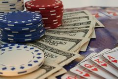 Poker and vegas. Poker chips, money and cards royalty free stock photos