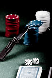 Poker vintage. Casino gambling chips, cards and knife  on green table Royalty Free Stock Photography