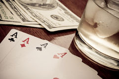 Poker, whiskey and Dollars Stock Images