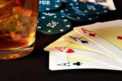 Poker, whiskey and money. Stock Photos