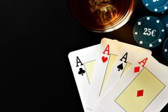 Poker, whiskey and money. Stock Images