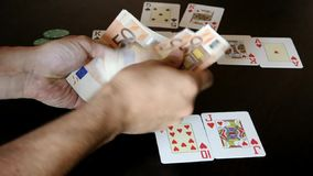 Poker winner counting fifty Euro banknotes stock video