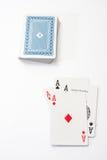 Pokerasse auf dem weißen Hintergrund Stockfotos