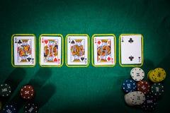 Pokerbegrepp med kort på den gröna tabellen Hand-rang kategorier: Fyra av en sort Royaltyfria Bilder