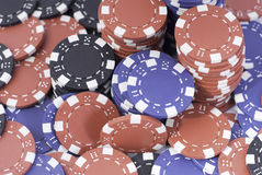 Pokerchips. Red, black and blue poker chips Stock Photo