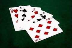 Pokerhände - vier einer Art - neun und acht Stockfoto