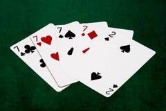 Pokerhänder - fyra av en sort - sju och två Fotografering för Bildbyråer