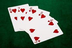Pokerhänder - rak spolning åtta till fyra Arkivfoton