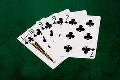 Pokerhänder - stålar för rak spolning till sju Arkivbild