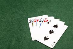 Pokerhänder tre av en sort Royaltyfria Bilder
