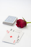 Pokers aces and red rose on the white background Royalty Free Stock Photos