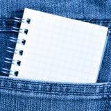 poket тетради джинсыов Стоковое Изображение RF