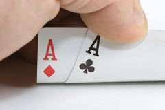 Poket Aces. Poker Pocket Aces with hand on white Stock Images