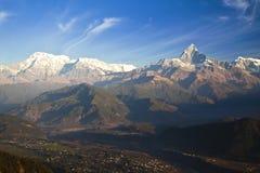 Pokhara and the Himalayas at Dawn, Nepal. Dawn image of the town of Pokhara, Nepal set against the Dhaulagiri-Annapurna-Manaslu Himalayan Mountain Range as a royalty free stock image