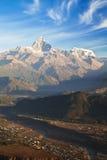 Pokhara and the Himalayas at Dawn, Nepal. Dawn image of the town of Pokhara, Nepal set against the Dhaulagiri-Annapurna-Manaslu Himalayan Mountain Range as a stock photo