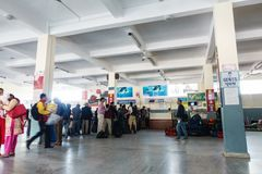 Pokhara airport interior. POKHARA, NEPAL - CIRCA NOVEMBER 2017: People are queuing to check in at Pokhara airport stock photography
