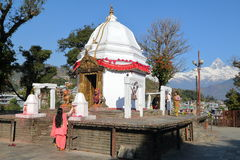 POKHARA, NEPAL - JANUARY 9, 2015: Bindhya Basini Temple with the Himalaya mountains  Machapuchare Peak in the background Stock Image