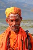 POKHARA, NEPAL - JANUARY 4, 2015: Portrait of a Sadhu or Holy man along the shore of Phewa Lake Royalty Free Stock Images