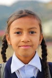 POKHARA, NEPAL - JANUARY 8, 2015: Portrait of a school girl with her school uniform Royalty Free Stock Photography